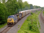 CSX 7707 heads a rack train