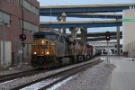 Stretched out back through the station, 281 slowly rolls west
