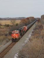 Loaded oil train U260 comes south on the Waukesha Sub