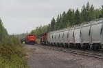 S733 heads north past the waiting U718
