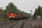 After waiting for opposing traffic, CN 5318 takes off south leading U718