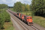 About to pass under Minnesota 37, three Canadian EMD's lead ore south for Proctor