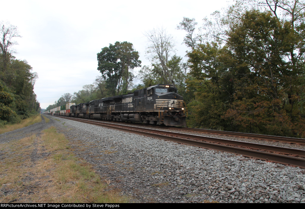 NS 9234 takes an eastbound container train through MP143.5