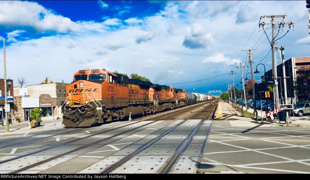 BNSF 6735 Leading the manifest mixed train