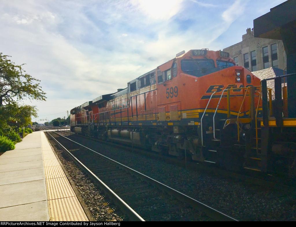 BNSF 599 EX: Santa FE 666 trailing on a manifest mixed train
