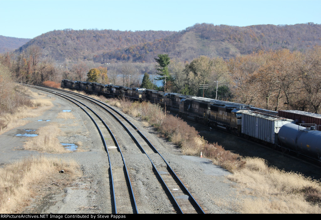 NS 6930 leads train 35A out of Enola yard while H15 couples the rest of its train alongside