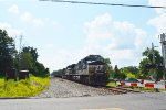 NS 9824 Approaches the Grade Crossing