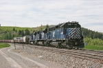 MRL 382 and 2 ACE's just cut away after shoving a grain train.