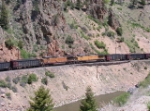 Mid-train helper set on loaded EB coal train through Byers Canyon