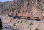WB loaded coal train negociating Byers Canyon