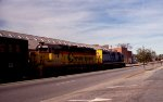 CSX 6130 & 6639 lead a train through the middle of town
