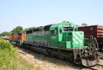 FURX 3008 & BNSF 4897 sit in a siding as a CSX train rolls by
