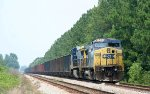 CSX 7685 is on the lead of a rock train in a siding