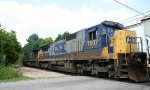 CSX 7607 helps lead an empty rock train north
