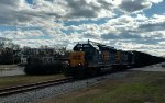 CSX 6419 & 2235 lead a long string of empty woodchip hoppers northbound