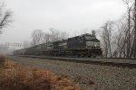 NS 9747 leads a coal train east through MP 116