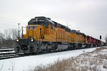 UP 1843 leads a sister and two home road units, all standard cab EMD, on CP train 281