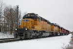 UP 1843 and three helpers muscle CP train 281 back into motion