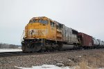 The lemon cab SD70ACC goes it solo on CP 581, WB oil MTs