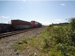 CN 2938/3122 W/B intermodal through Colebrook on the main, meeting CP 8886/8755 empty coal train in the siding