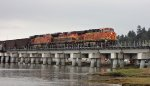 BNSF/KCS power S/B across the south end of the Mud Bay Crossing.