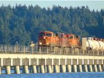 BNSF 7419/CP 8721/BNSF 6105 making its way slowly across Mud Bay Crossing