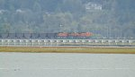 Distant shot of BNSF/KCS power leading an empty coal train S/B at the north end of the Mud Bay Crossing