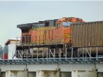 Trailing DPU BNSF 4106, S/B empty coal gondola train at the south end of the Mud Bay Crossing