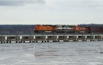 BNSF 7805/9794/967 leading a N/B mixed freight consist on the Mud Bay Crossing.