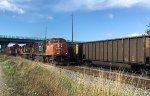 CN 5726/2506/2329 E/B stack train passing a CP loaded coal train, waiting in Pratt Siding