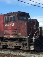 Mid-train DPU CP 8943, W/B loaded coal train, waiting in Pratt Siding.