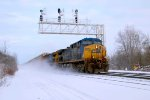 CSX 265 kicks up a blizzard as it passes beneath the CP382 WAS signals