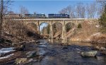 MEC 5936 leads train symbol 11R northbound across the stone arch bridge in Bernardston, MA