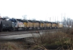 6 UP SD 40's lead a mixed freight...