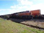 BNSF 7086 trailing DPU, E/B Coal train (empty), Fisher Siding, grafitti on locomotive
