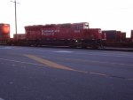 CP 5015 moving intermodal containers at sunset, Robert's Bank Yard, west end