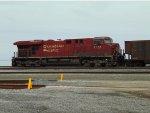 Trailing DPU CP 8778, E/B at the west end of Roberts Bank Yard pushing an empty coal hopper train