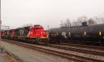 CN 5486 leads 4 CN locomotives S/B through the CN/BNSF New Westminster Yard with a mixed freight consist