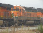 BNSF 7470/1664/291 in the smoky CN/BNSF New Westminster Yard