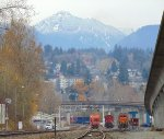 Looking NE past the BNSF New Westminster office/Braid Street, to snow covered Mt. Coquitlam in the background