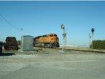 BNSF loaded W/B coal train, with trailing DPU BNSF 6111 just entering Control Point Gulf