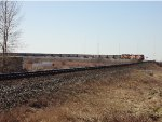 BNSF 6267 in the lead, empty coal hoppers, E/B in Mud Bay West curve