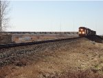 BNSF 6267 in the lead, E/B with empty coal hoppers, just exiting Mud Bay West curve, north of the Hwy 99 overpass.