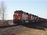 BNSF 6267 in the lead, empty coal hoppers, E/B approaching 112th Street crossing, Mud Bay West.