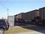 BNSF empty hopper coal train, E/B just passing the 112th Street crossing, Mud Bay West.