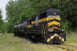 TKEN 9434 sits with two tank cars to take back south