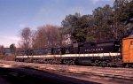 A trio of GP30's leads a train thru the yard