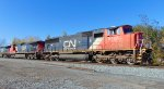 CN 5768/2708/2718 E/B with a unit stack train, approaching the 88th Street crossing