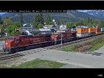 Two Canadian Pacific Locomotives Lead an Intermodal Train Through Revelstoke