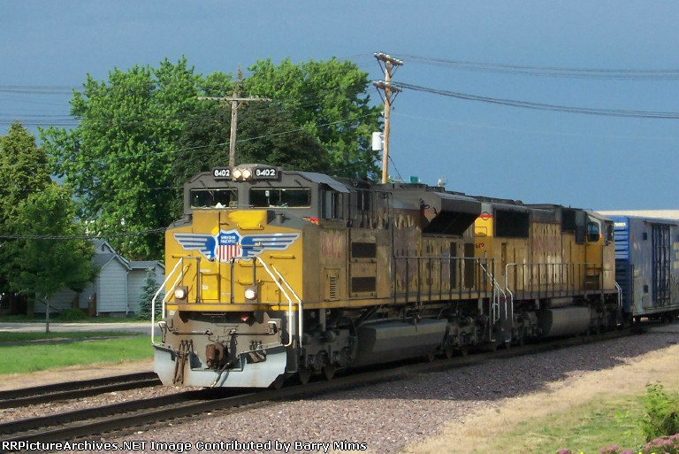 UP 8402 leads westbound freight.